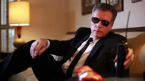 Snack Break For Secret Services Agent stock footage
