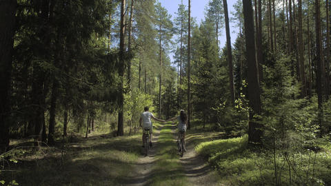 Young Couple Cycling In Nature Footage