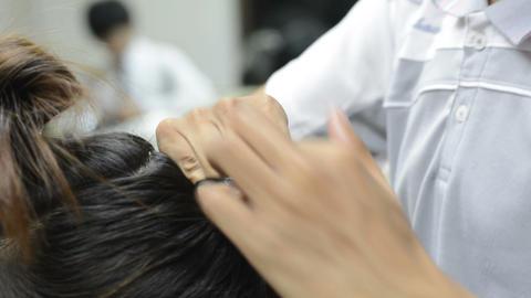 Hairdresser or barber makes the hair for beauty ビデオ