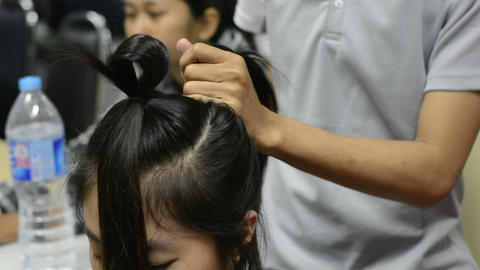Hairdresser or barber makes the hair for beauty Footage