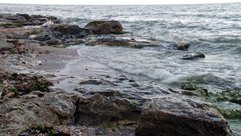 Sea waves which break the shore of a beach with rocks Footage
