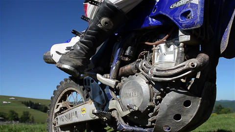Man Starts With The Leg Of A Motorcycle Engine 01 stock footage