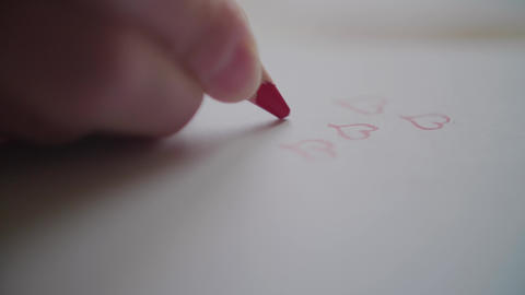 Hand drawing many hearts by red pencil on Valentine's day Footage