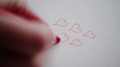 Hand drawing few hearts by red pencil on Valentine's day Footage