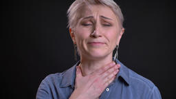 Closeup portrait of ill adult caucasian female coughing having a sick throat and Footage