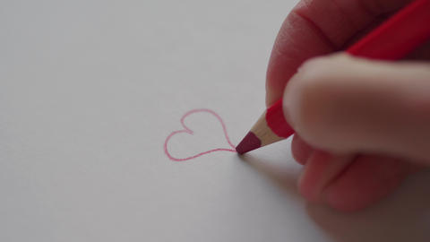 Hand drawing small heart by red pencil for Valentine's day Archivo