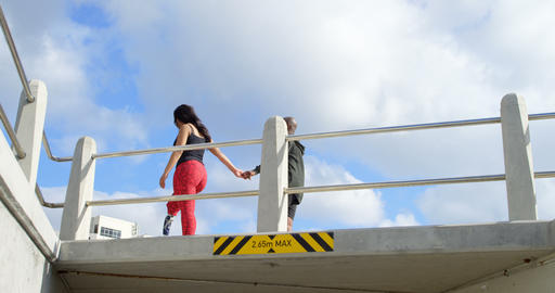 Couple walking with hand in hand near railing 4k Live Action