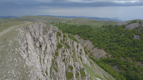 Couple in mountains on the edge of an impressive cliff in Crimea Live Action