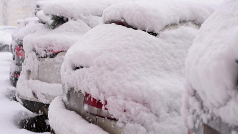 Snow covered cars Footage