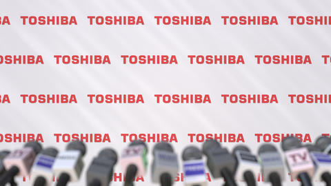 Media event of TOSHIBA, press wall with logo and microphones, editorial Footage