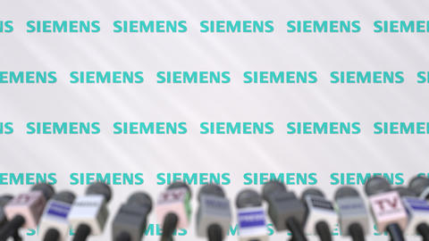 Media event of SIEMENS, press wall with logo and microphones, editorial Footage