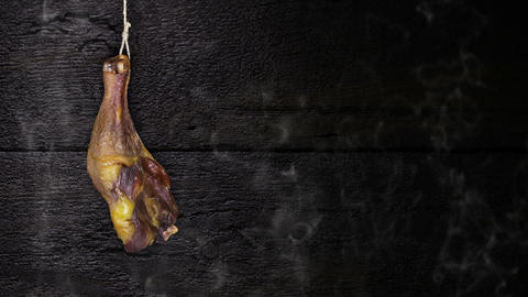 Chicken Meat Hanging On The Rope Against Rustic Wooden Background CG動画素材