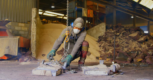 Worker operating crane in foundry workshop 4k Live Action