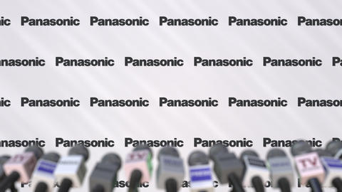 Press conference of PANASONIC, press wall with logo and microphones, conceptual Footage