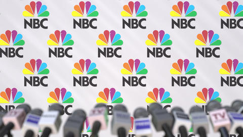 Press conference of NBC, press wall with logo and microphones, conceptual Footage