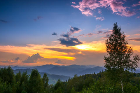 Multicolor Sunset Sky in Forested Mountains フォト