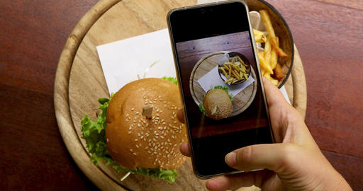 Crop hand taking pictures of food on table 영상물