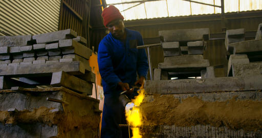 Male worker heating mold in workshop 4k Live Action