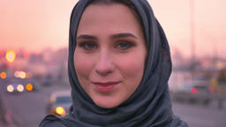 Closeup portrait of young charming muslin female in hijab happily smiling and Footage