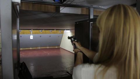 The Blonde Girl Shoots A Gun Footage