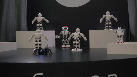 humanoid robot dance. Group of cute robots dancing. Close up of smart robot Live Action
