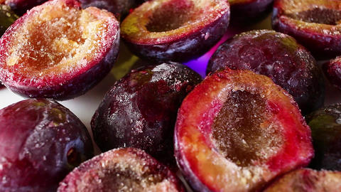 Frozen plum half plums seamless looping background closeup video Live Action