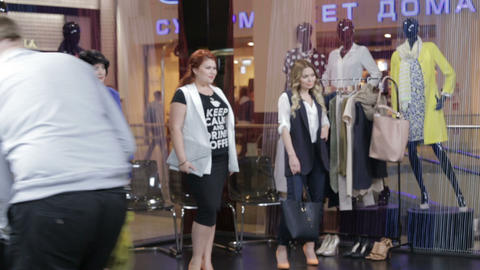 cameraman moves along models ready for shooting in mall GIF