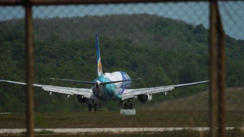 Airplane approaching and landing at Phuket airport GIF
