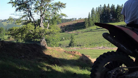 Motorcyclists that their motocross climb a small ravine in the fir forest 05 Footage