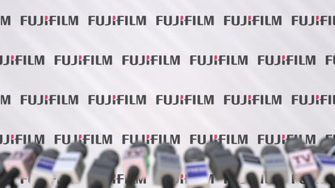 Media event of FUJIFILM, press wall with logo and microphones, editorial Footage