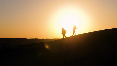 Two male silhouettes in desert Footage