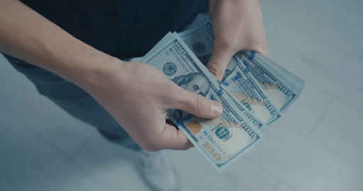 Close up Man counts money. Dollars in hand, money in hand, counts the money Live Action