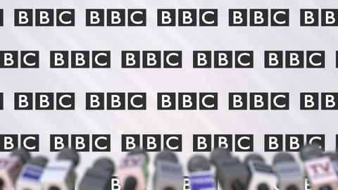 BBC company press conference, press wall with logo and mics, conceptual Footage