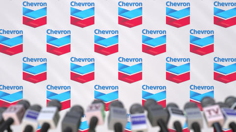 News conference of CHEVRON, press wall with logo as a background and mics Footage