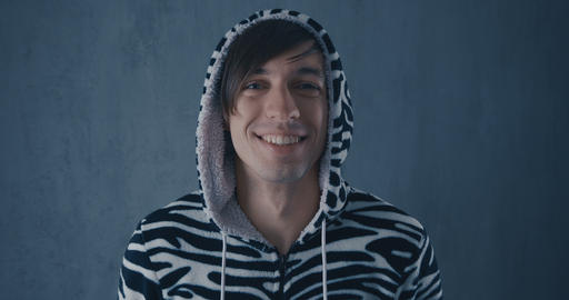 Portrait of Young Man in kigurumi zebras on gray background Footage