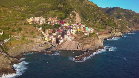 Aerial view of Manarola village on cliff rocks and turquoise sea. Stunning view Footage