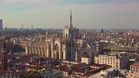 Aerial drone footage of famous statue on cathedral Duomo of Milan Italy Footage