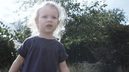 Adorable Toddler Stretching Out Arms Outdoors Live Action