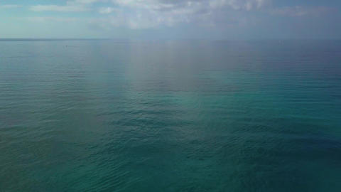 Aerial shot, incredibly beautiful calm sea with lots of clouds, white beach Footage
