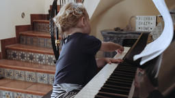Adorable Blond Toddler Playing Piano Live Action