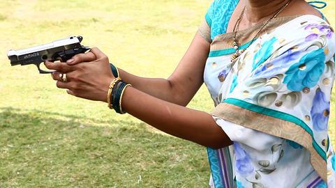 Revolver Female hand Live Action
