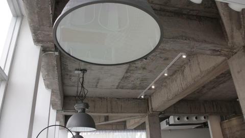 Modern black metal hanging lamp in loft room Footage