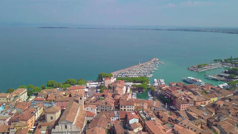 Aerial view overlooking beach and lake in Limone sul Garda, Lake Garda Footage