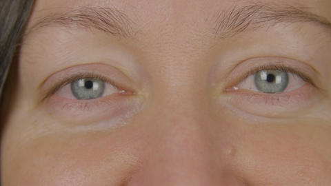 Close up blue woman eyes. Eyes close up. Beauty woman face. Human eye macro Footage