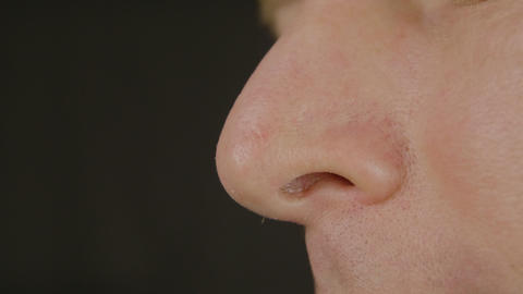 Men's nose, close-up Live Action