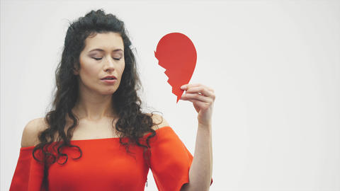 Portrait of a beautiful woman on a white background. Bad Valentine's Day. The Footage