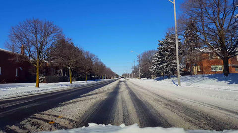 Driving on Snow Covered Road in Day. Driver Point of View... Stock Video Footage