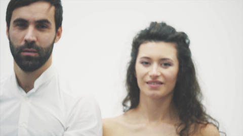 Loving tender pair on white background. Serious people. A... Stock Video Footage