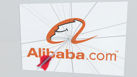 Archery arrow breaks glass plate with ALIBABA company logo. Business issue Live Action