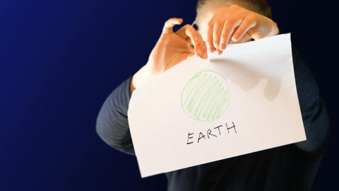 teenage girl, holding a sheet of paper with a drawing representing the earth Live Action